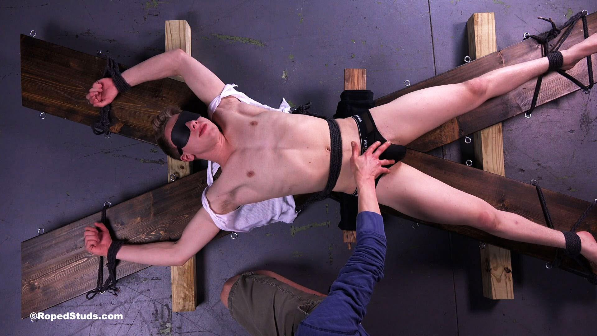 naked boy cross bondage